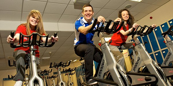 James McCallum, Scottish cyclist, and two females on the bikes at the University of Strathclyde's Centre for Sport & Recreation