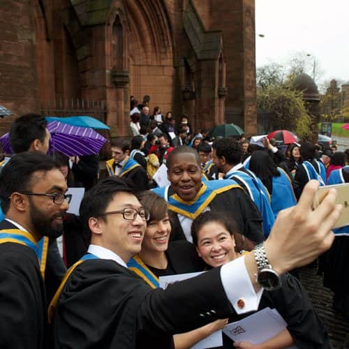 a group of students pose for a selfie straight after graduation