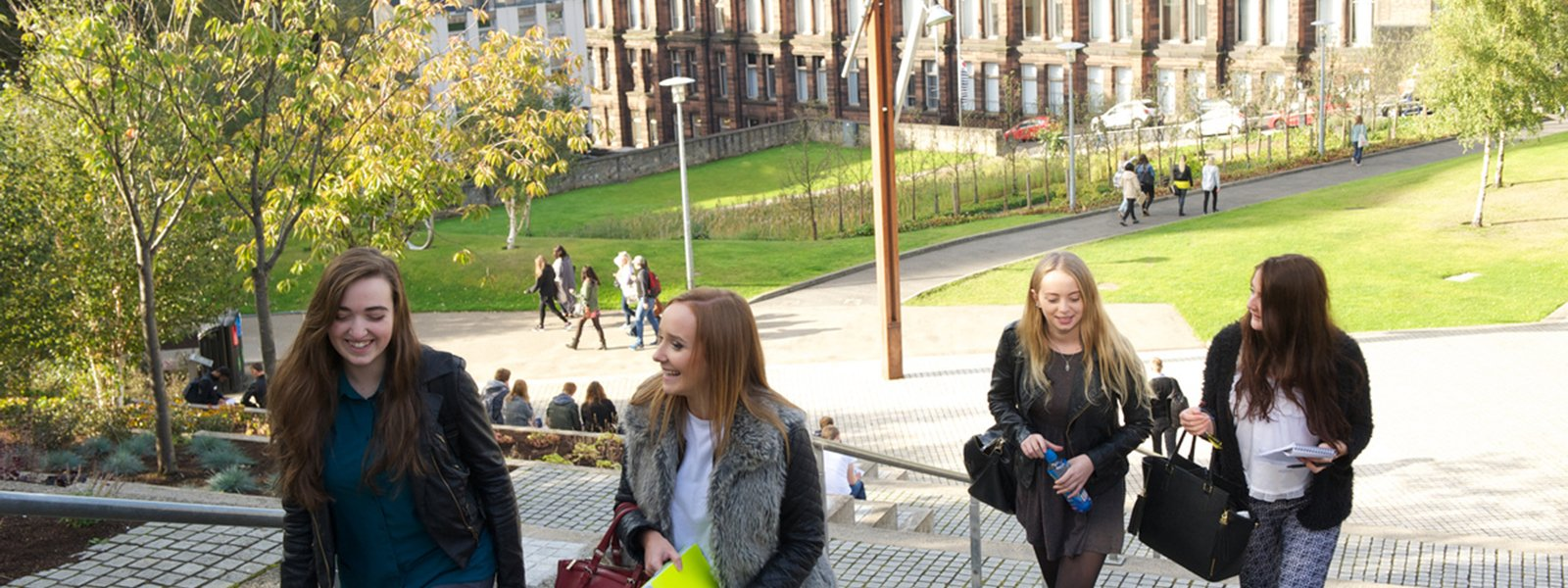 female students climbing stairs at Rottenrow Gardens, University of Strathclyde