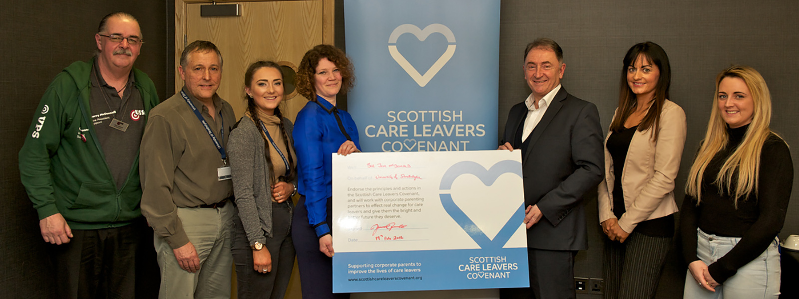 Professor Sir Jim McDonald signs the Scottish Care Leavers' Covenant on behalf of the University of Strathclyde