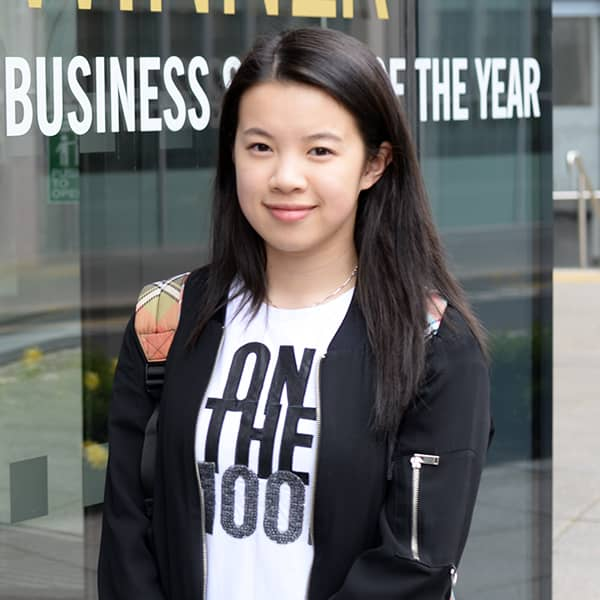 Mathematics student, Jessie Sou, standing outside the Strathclyde Business School
