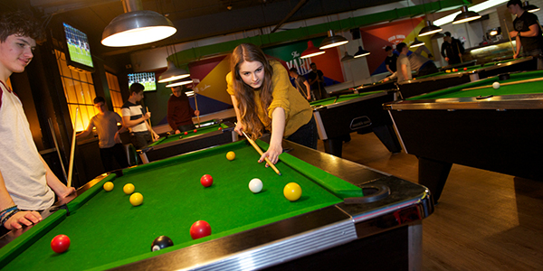 Male and female student playing pool in the Students' Union