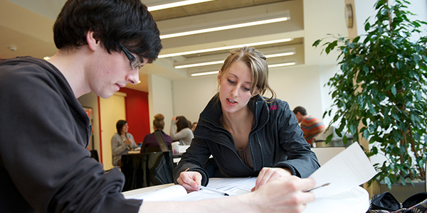 Male and female student in discussion