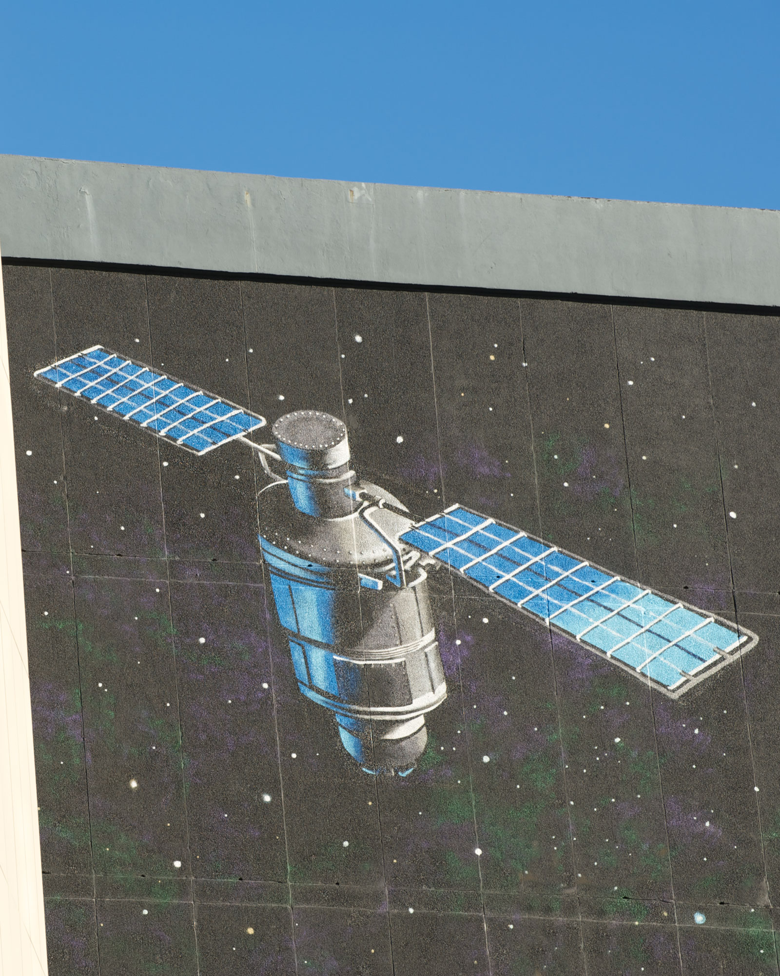 A satellite painted on the top of the graham hills building gable end