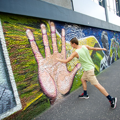 student hi=fives a large hand painted on the strathclyde wonderwall