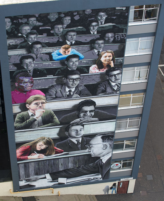 Students of the past and present painted on the gable end of Graham Hills Building on North Portland St