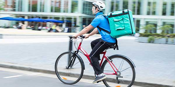Courier on a bicycle delivering food in a city