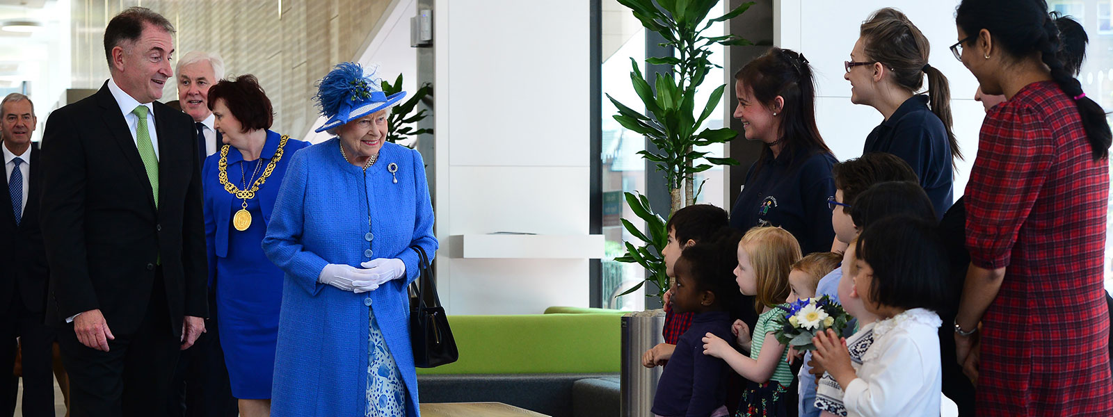 Principal, Professor Sir Jim McDonald introduces The Queen to members of Strathclyde's creche.