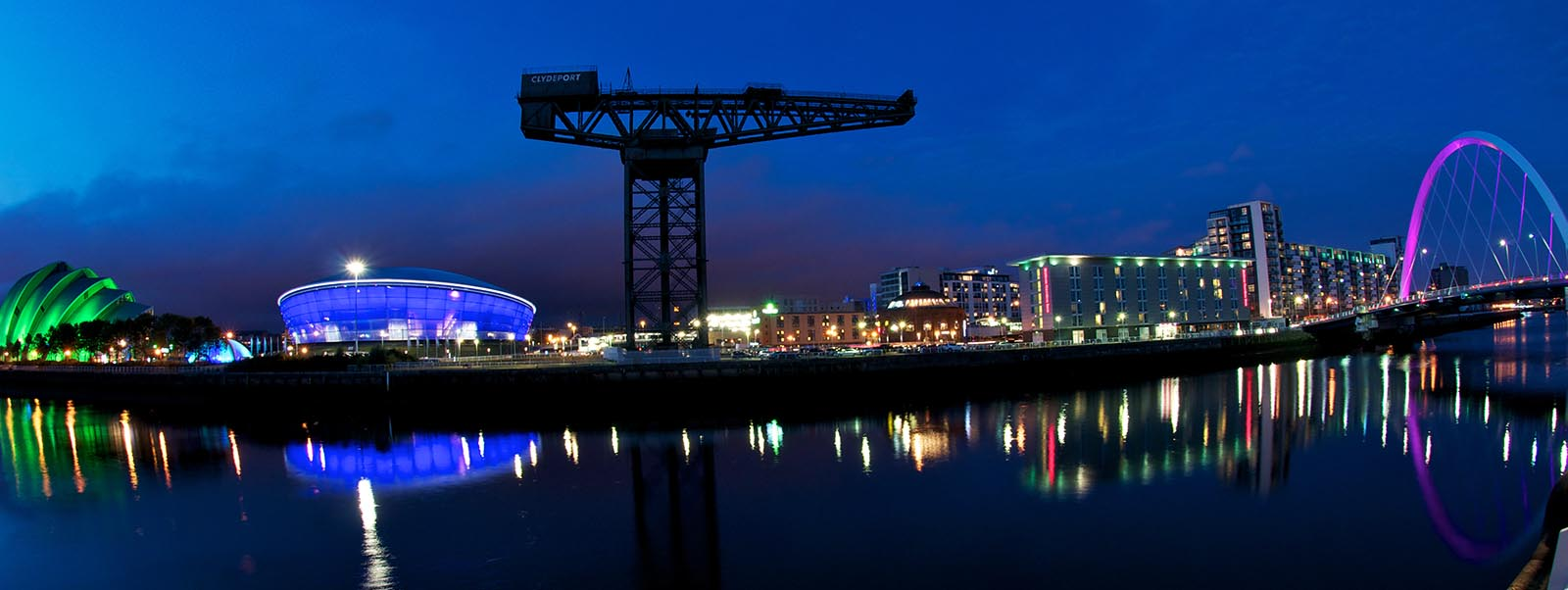 The River Clyde, Glasgow, at night. The Hydro, Clyde Auditorium and Finnieston Crane in shot