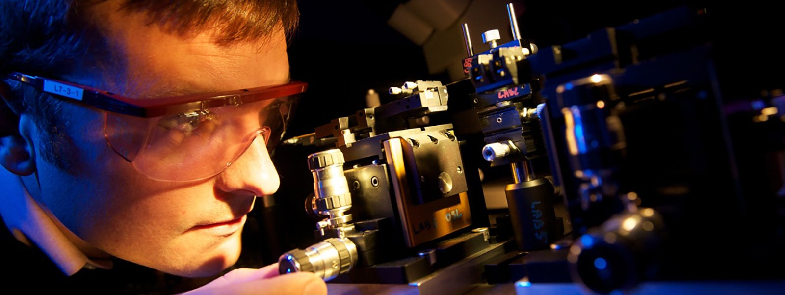 Student setting up a laser rig