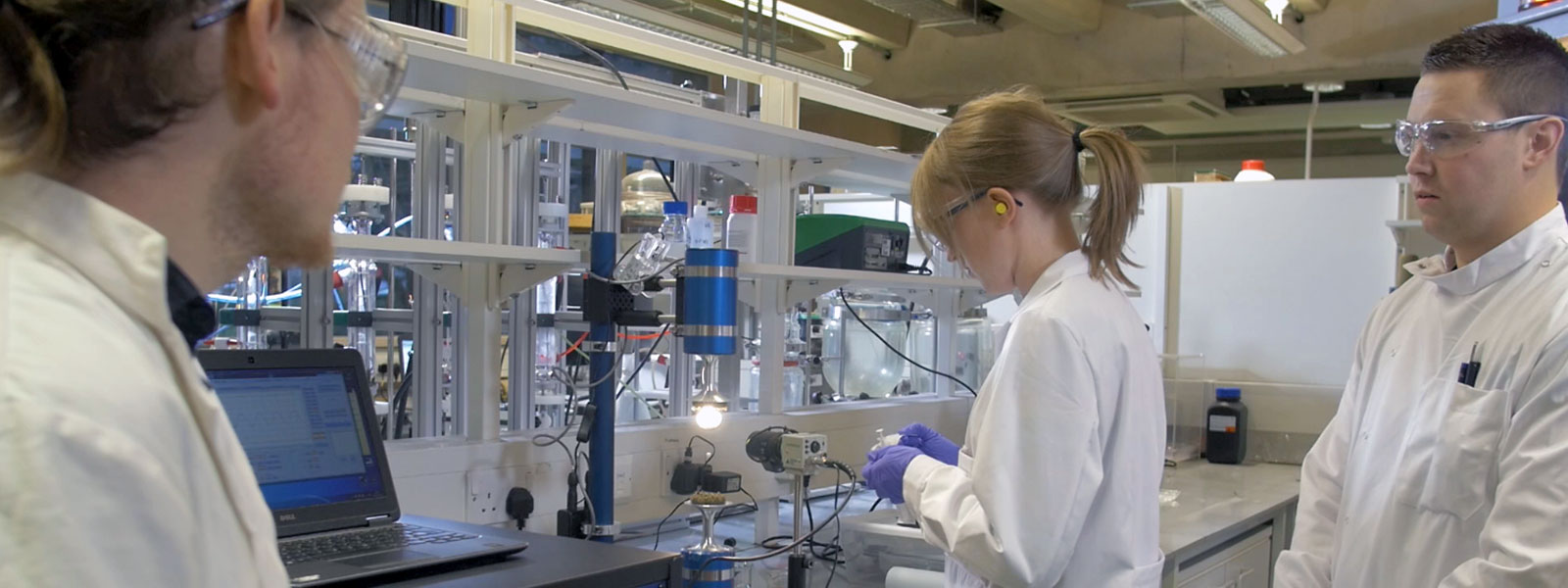 Scientists carrying out an experiment in a lab
