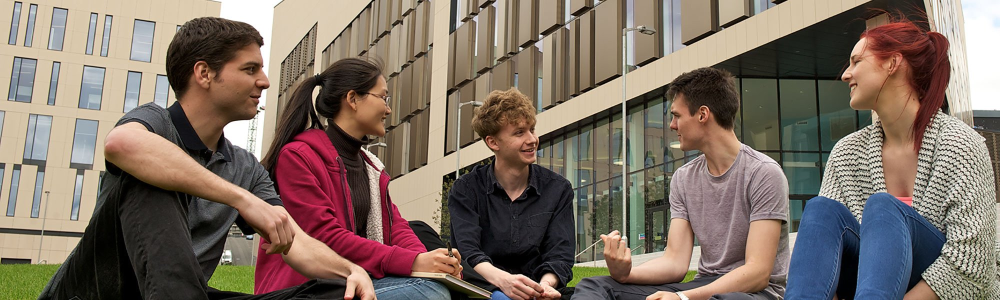 Research students sit outside the Technology & Innovation Centre