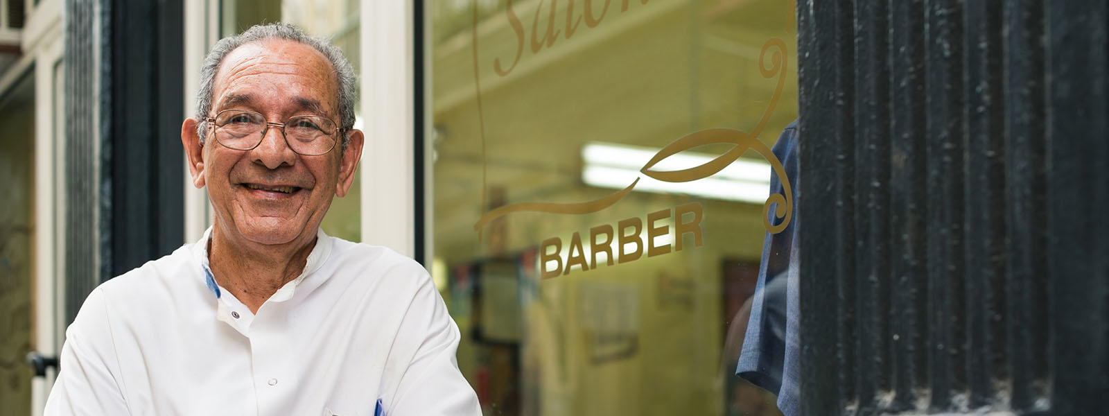 Man standing in front of barber shop