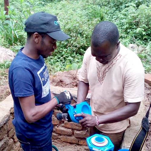 Environmental Engineering graduate, Denis Arinabo, assembling a zero-energy water pump during installation in Uganda.