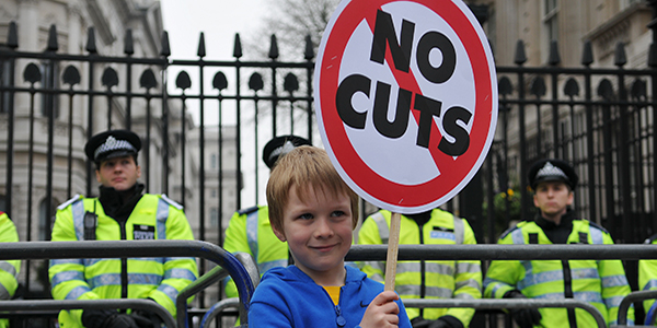 Young boy protesting about austerity cuts