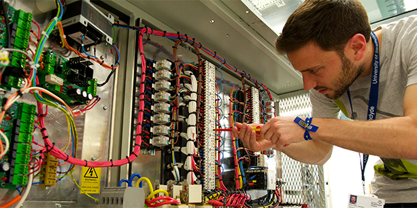 Student working in an electronic & electrical engineering lab