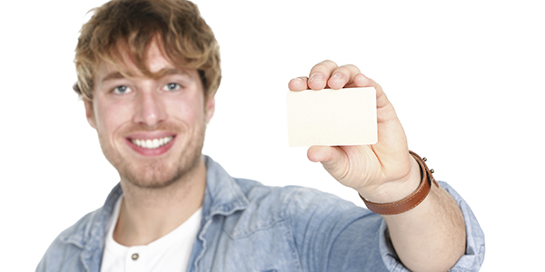 A student holding a blank student card