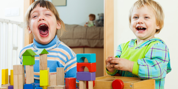 Two children playing with blocks