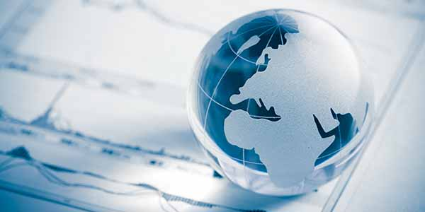 Glass globe of a map of Europe map and stock market chart on newspaper background