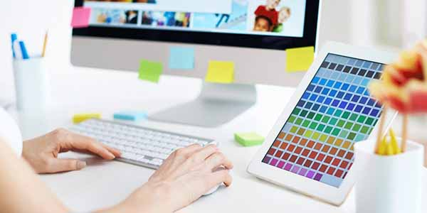 designer working with palette of colours at computer
