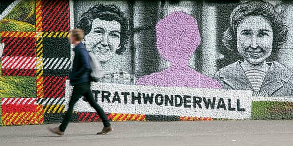 Student walking past the Strathclyde Wonderwall