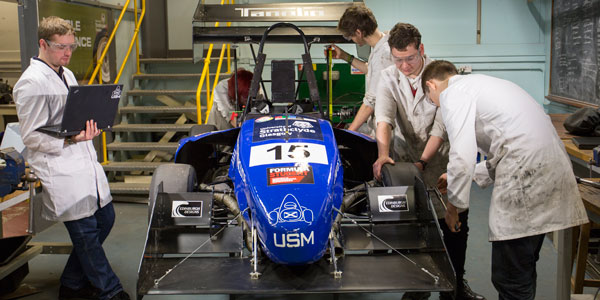 Students work on the formula student car