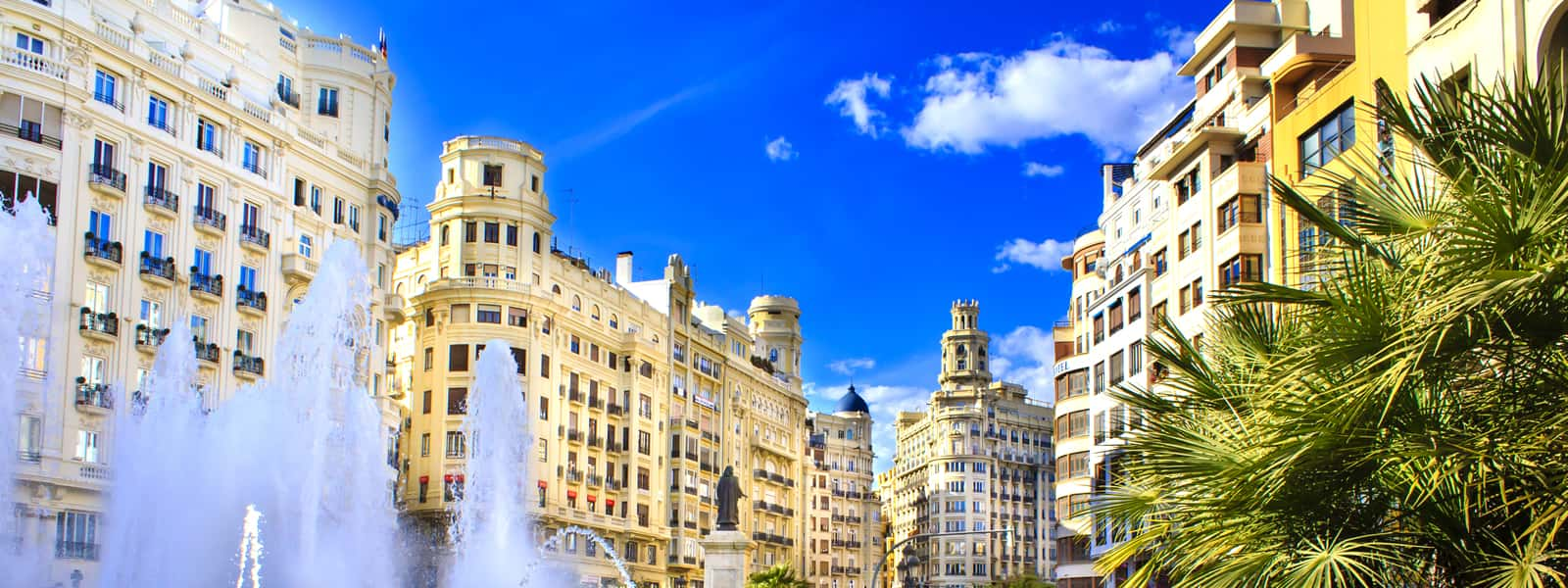 Main city square of Valencia, The Plaza del Ayuntamiento in bright afternoon colors, Spain