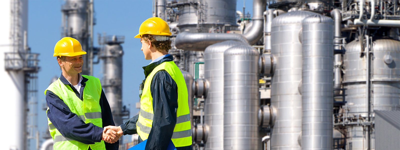 Two petrochemical contractors in front of an oil refinary