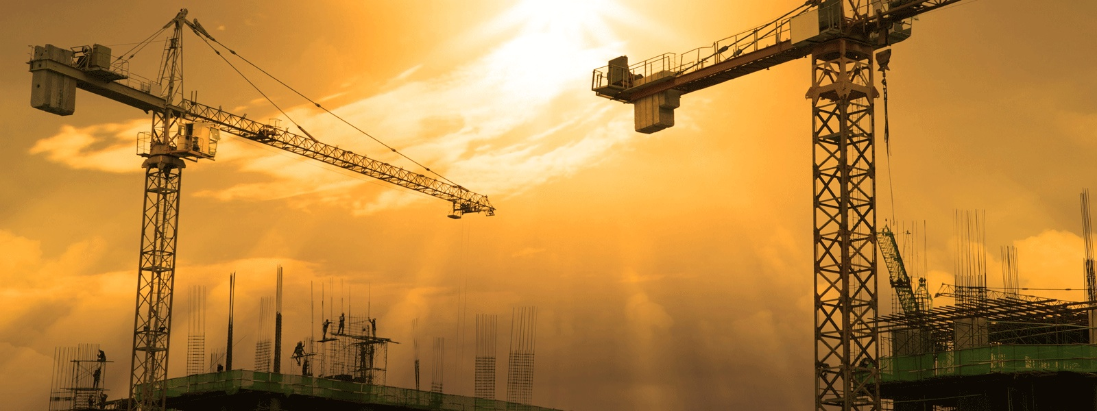 Cranes on Building site in sunset at 1600x600