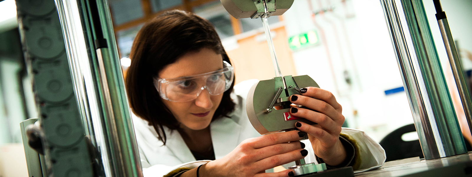 a female engineer works in a lab