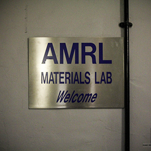 a photo of our sign that hangs outside the lab