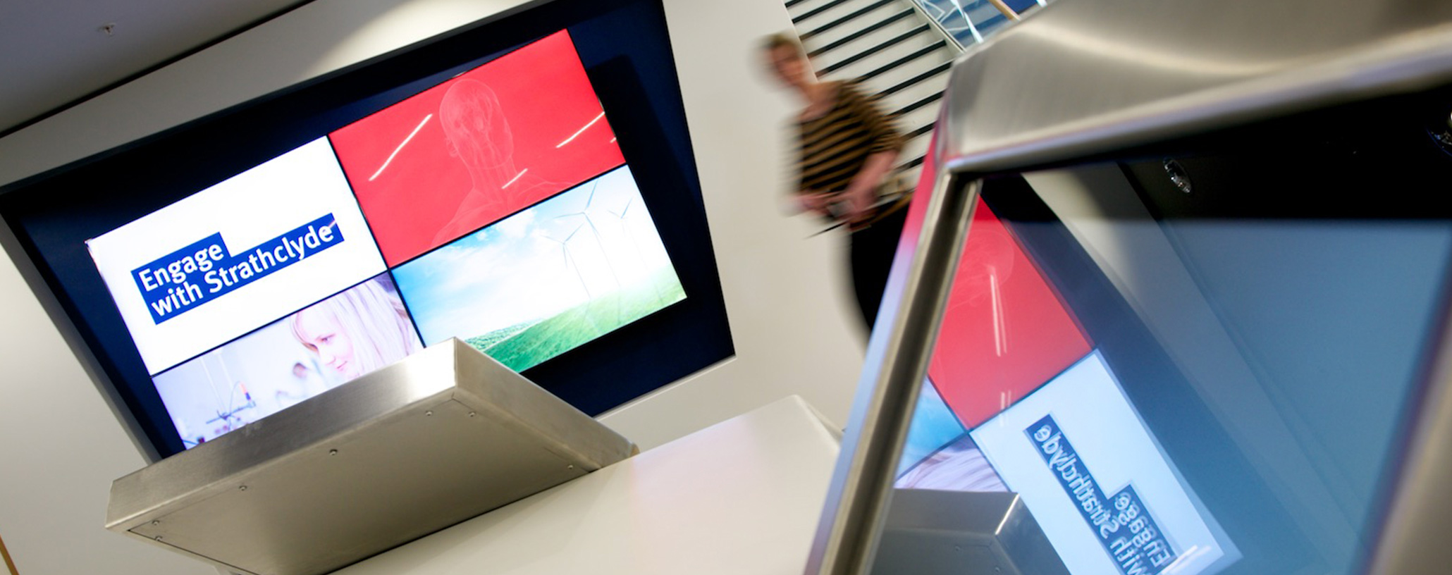 This image shows the TV display in the TIC building with the Engage with Strathclyde branding