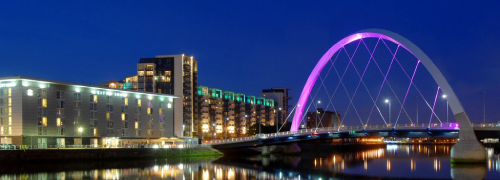 Clyde Arc bridge lit up at night